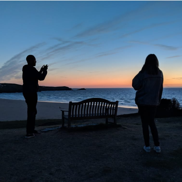 A photo of Tim taking a photo of a sunset in Cornwall. Photoception.